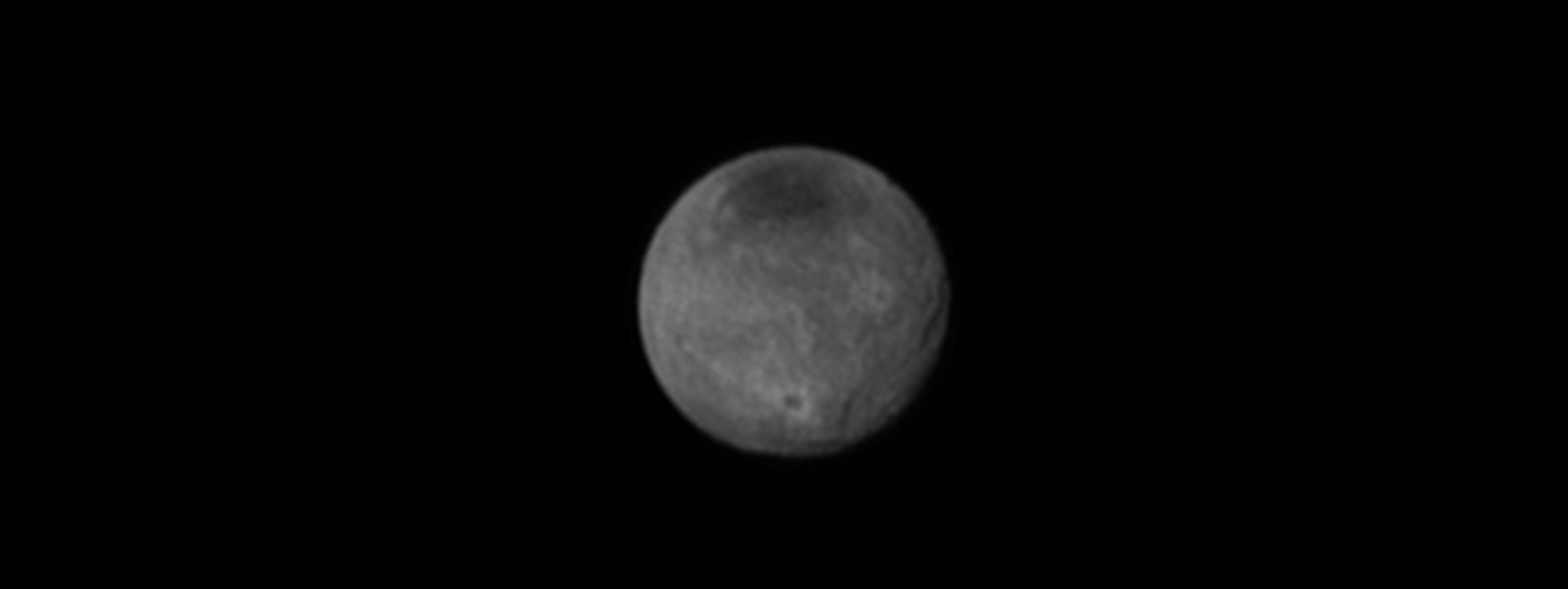 Charon Moon: Pluto And Charon Surprise With Chasms, Cliffs And Craters