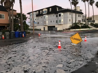 Large waves and tides flood the intersection of Cortez Avenue and Seacoast Drive in San Diego County's Imperial Beach.
