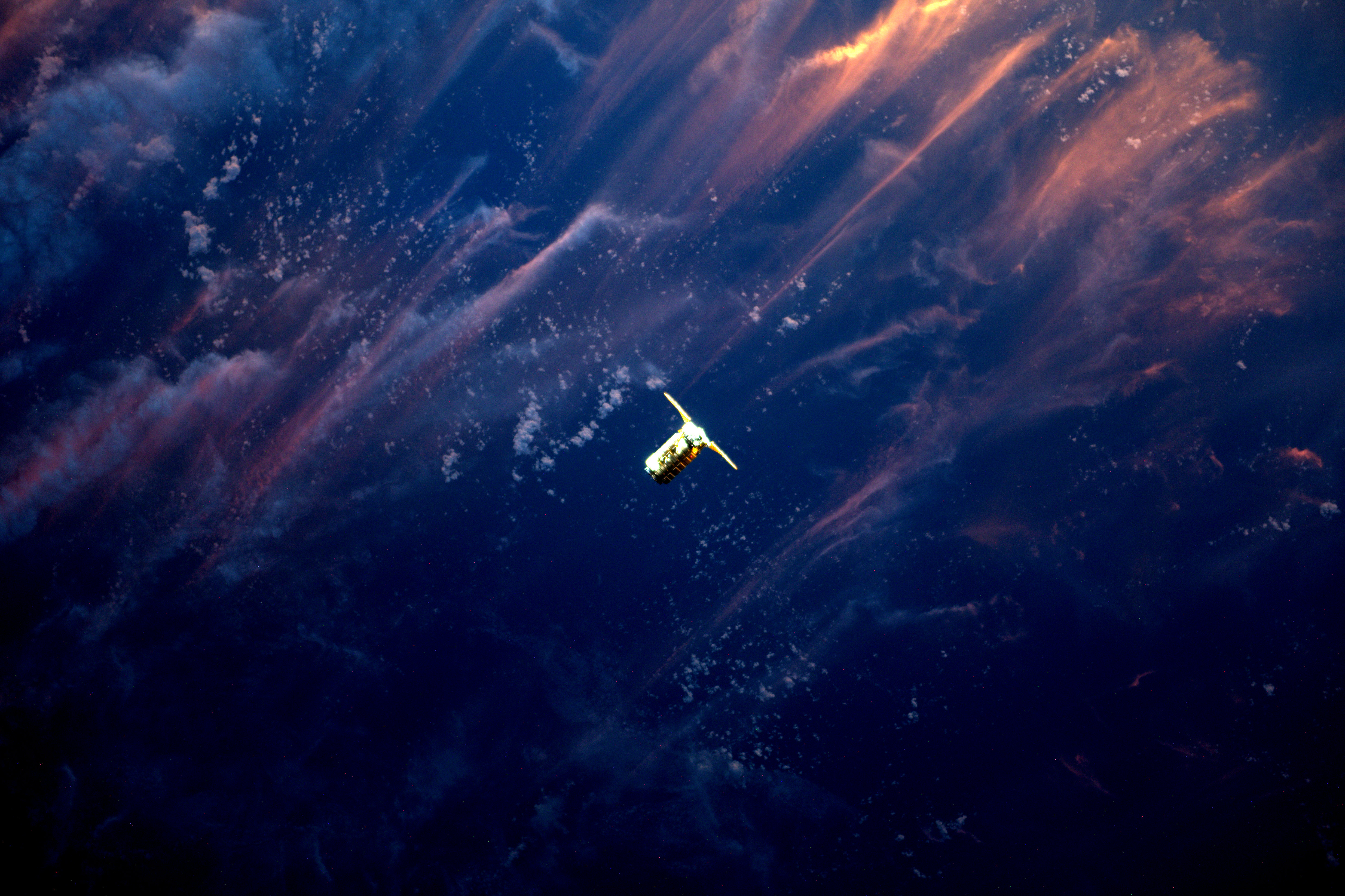 Cygnus Spacecraft Approaches Space Station in the Sunset