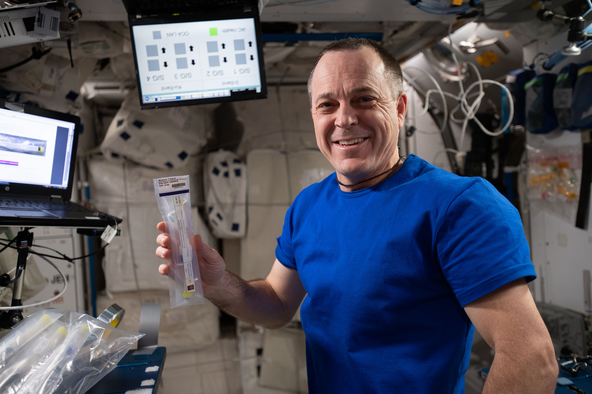 Astronaut Ricky Arnold Works With a Student-Designed Experiment