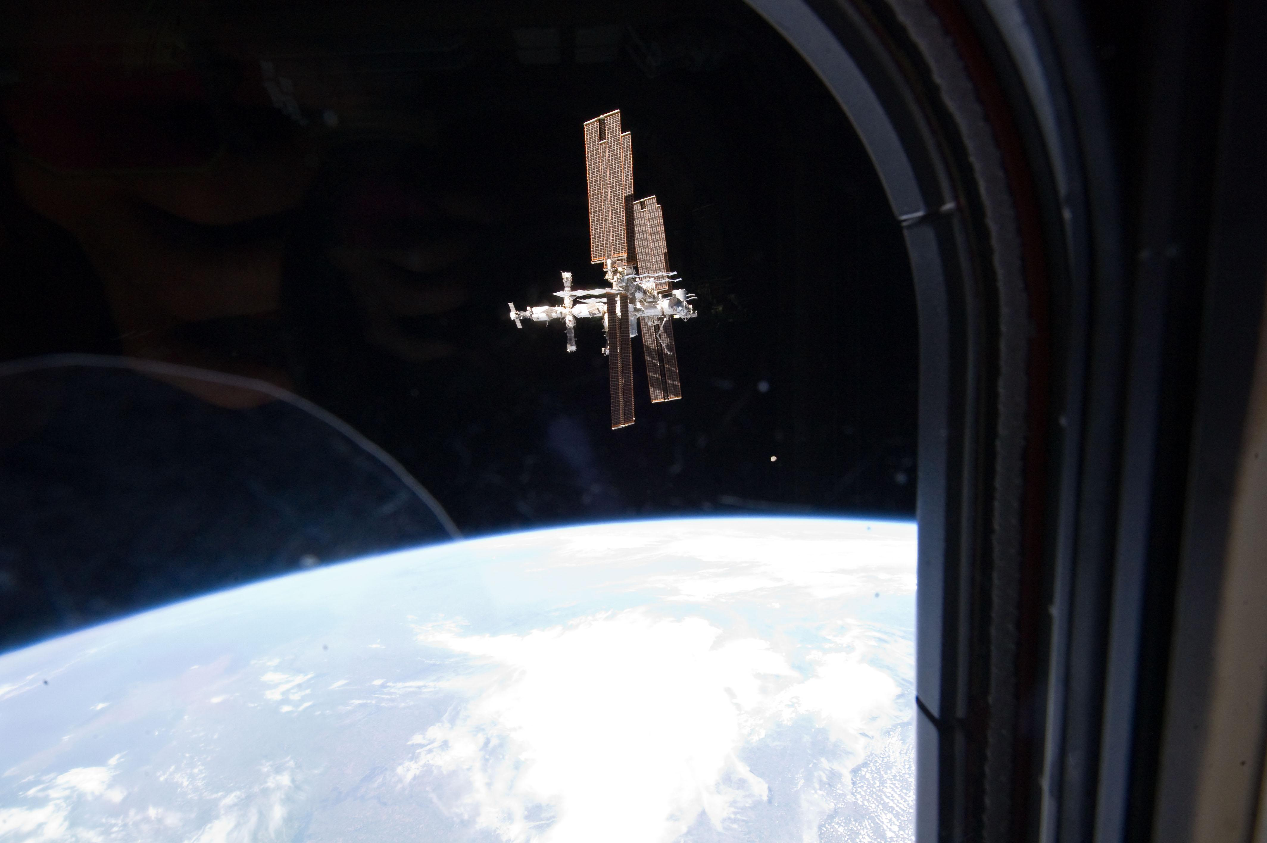 Space Shuttle Seen From Earth as Seen From Space Shuttle