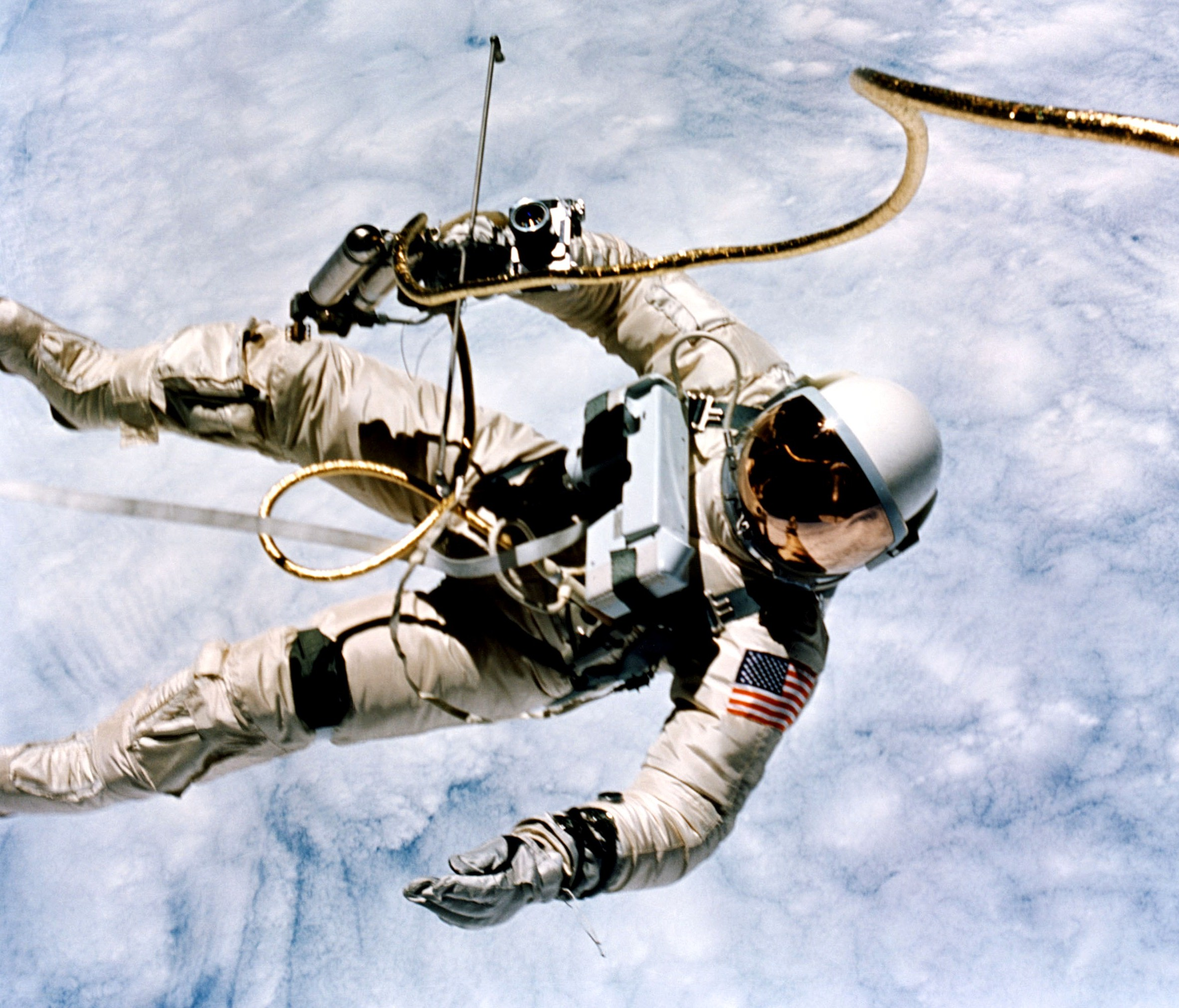 Ed White floating in space during the first American EVA on Gemini IV