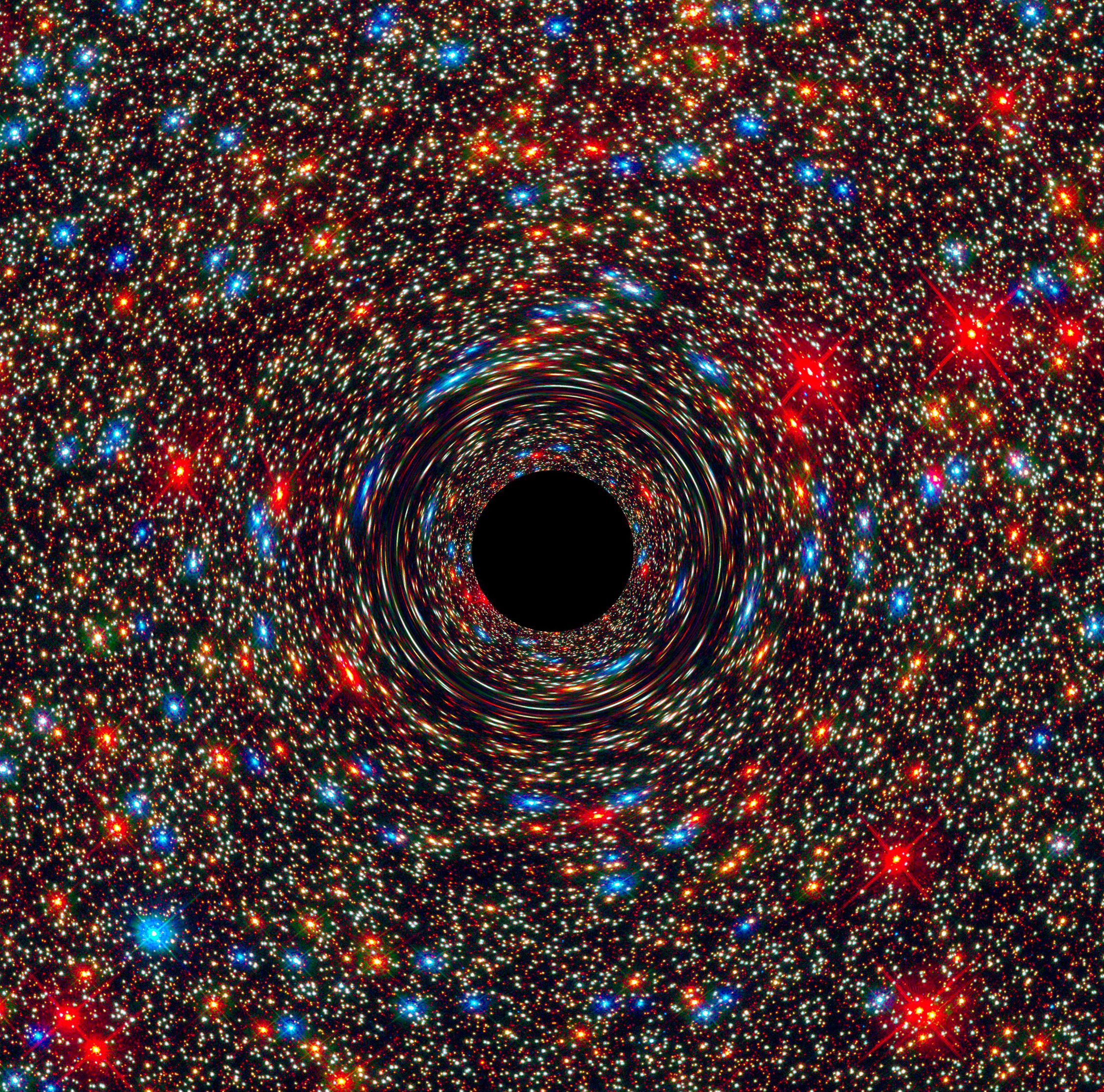 This computer-simulated image shows a supermassive black hole at the core of a galaxy. The black region in the center represents the black hole's event horizon, where no light can escape the massive object's gravitational grip. The black hole's powerful gravity distorts space around it like a funhouse mirror. Light from background stars is stretched and smeared as the stars skim by the black hole.  Credits: NASA, ESA, and D. Coe, J. Anderson, and R. van der Marel (STScI)