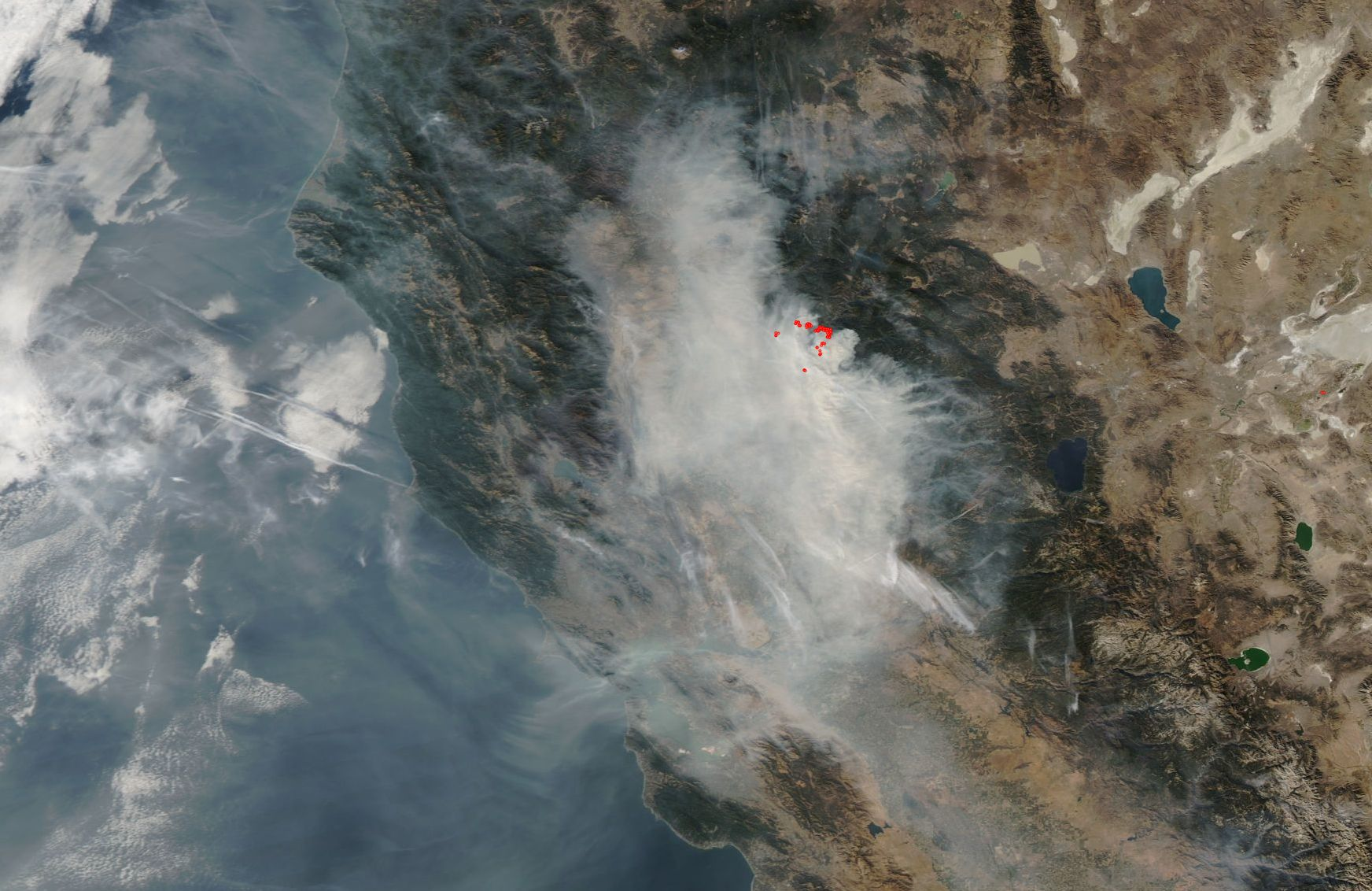 california shrouded in smoke from the ongoing camp fire nasa
