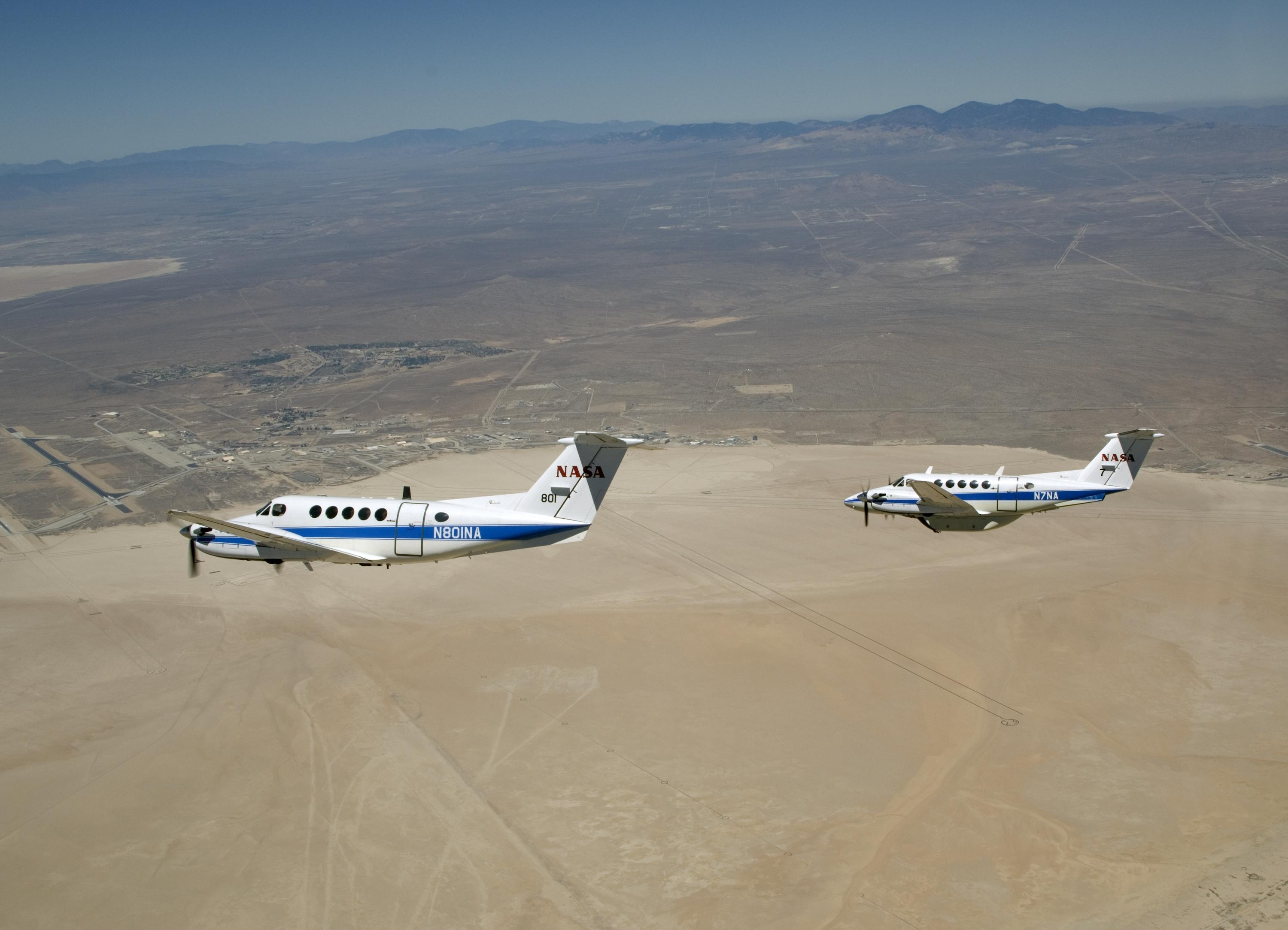 uk availability 94b37 4f0d6 Two Beechcraft King Air mission support aircraft in flight over  California s Mojave Desert.