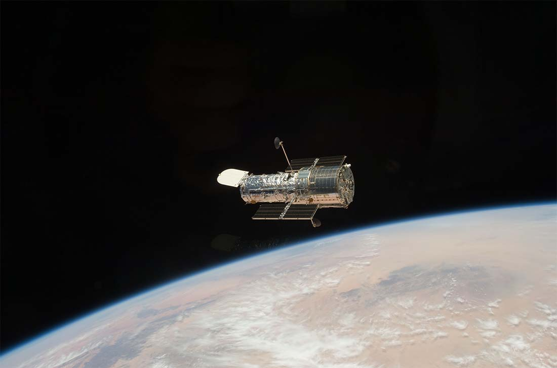 The Large Silver Hubble Space Telescope Orbits Above Earth