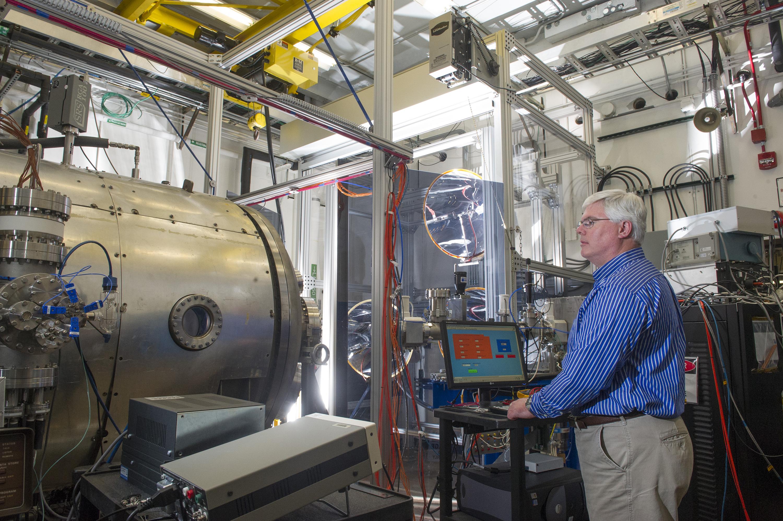 Robot Preparing To Build Large Light Composite Rocket Parts   NASA