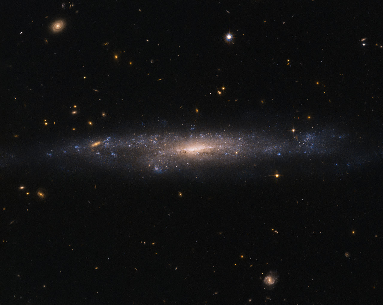 Hubble Sees Galaxy Hiding in the Night Sky | NASA