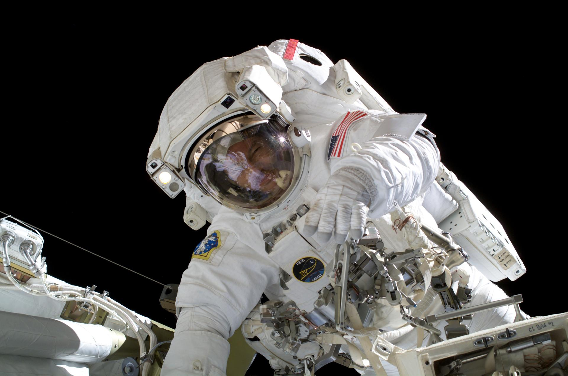 Astronaut Michael Lopez-Alegria Works on Constructing the International Space Station