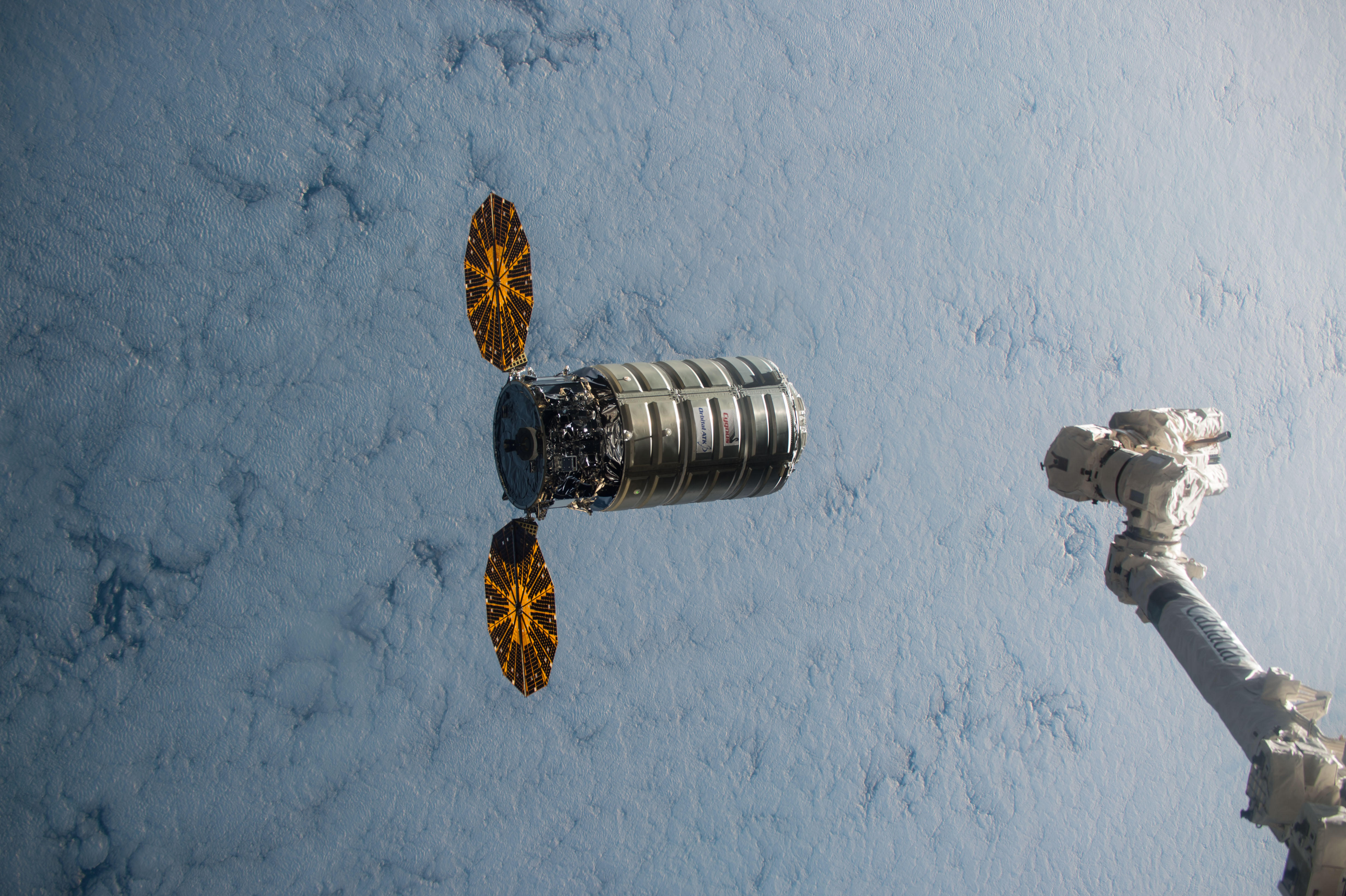 Small solar lights for crafts - Cygnus Spacecraft With Solar Arrays Deployed And Clouds Below Approaching Robotic Arm In Lower Right
