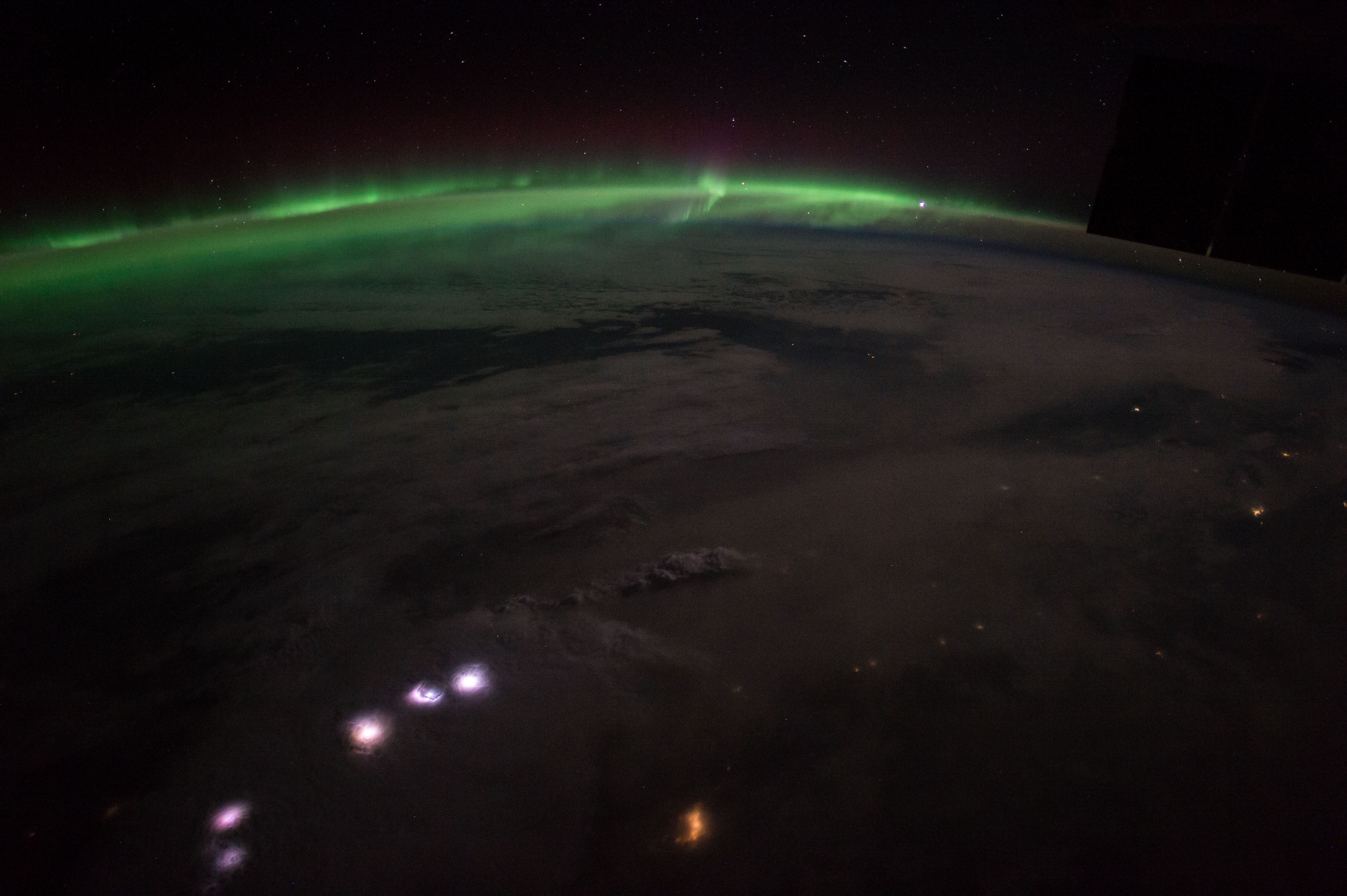 Jsc invites media to screening of documentary on ams nasa space station crew members captured this image of the aurora borealis and a lightning storm robcynllc Image collections