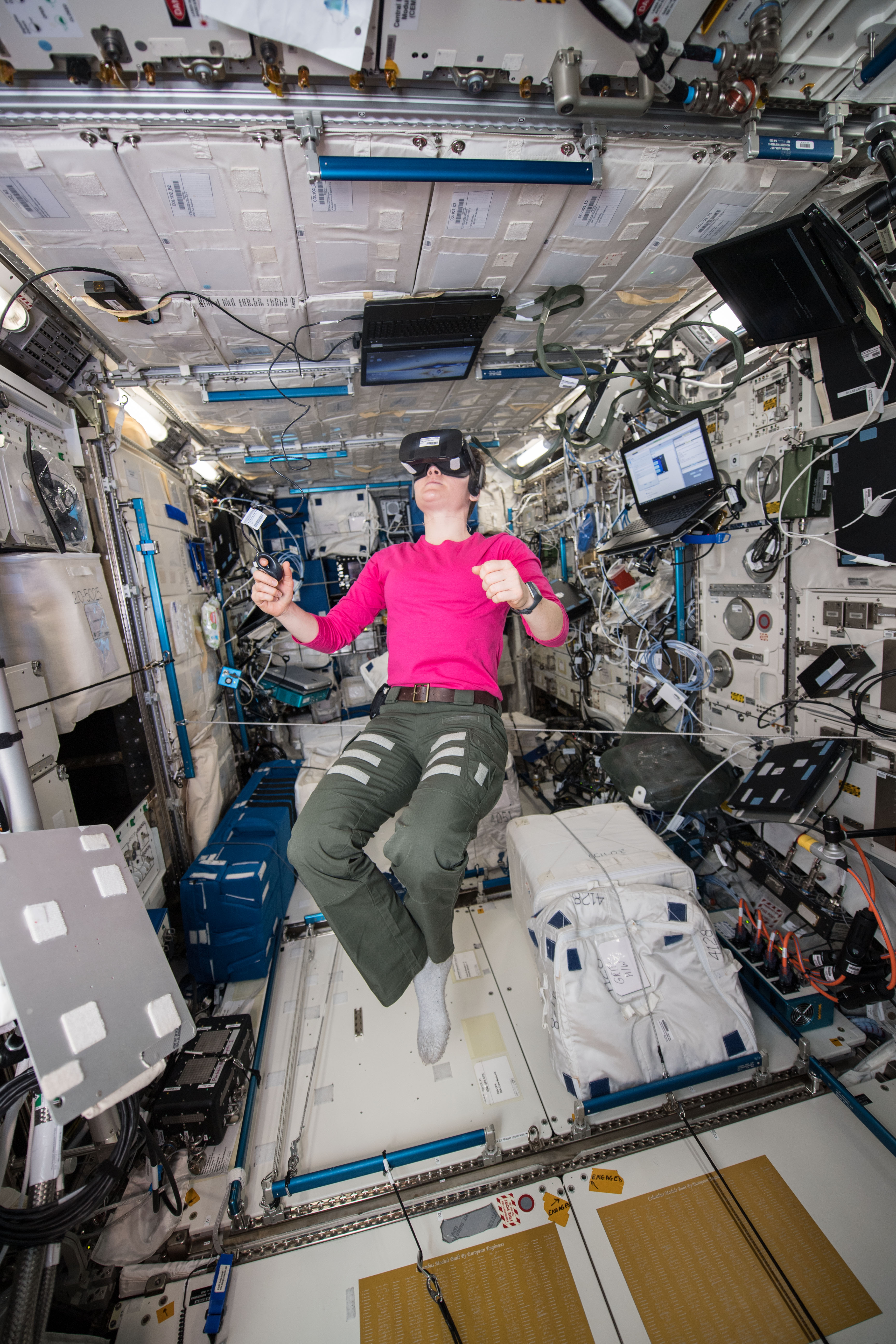 0d2a5ba6549a astronaut Anne McClain floating inside the space station wearing a virtual  reality headset