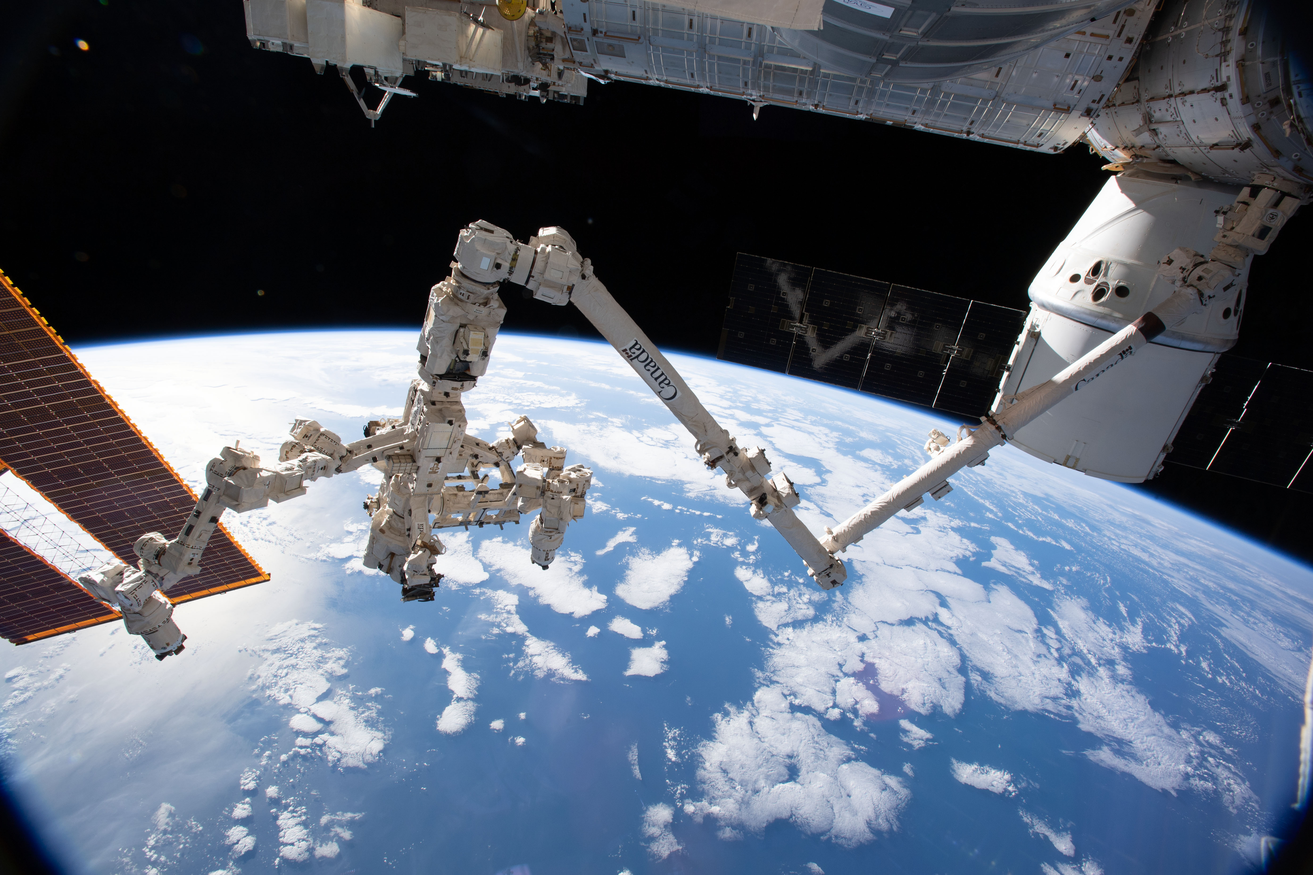 The Canadarm2 robotic arm with its robotic hand Dextre | NASA