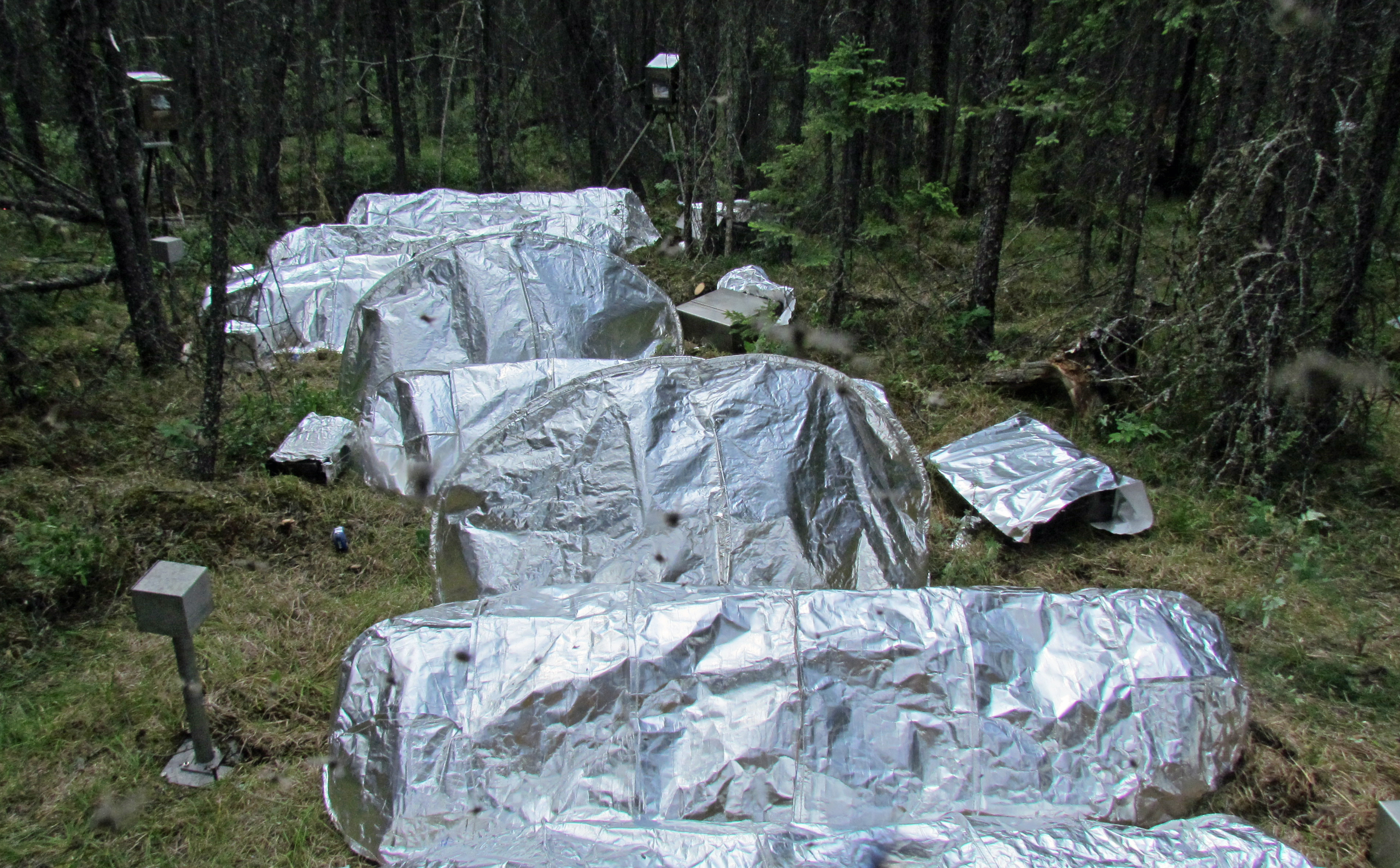 Model fire shelters are made from materials that reflect heat. & NASA Works with U.S. Forest Service to Improve Fire Shelters | NASA