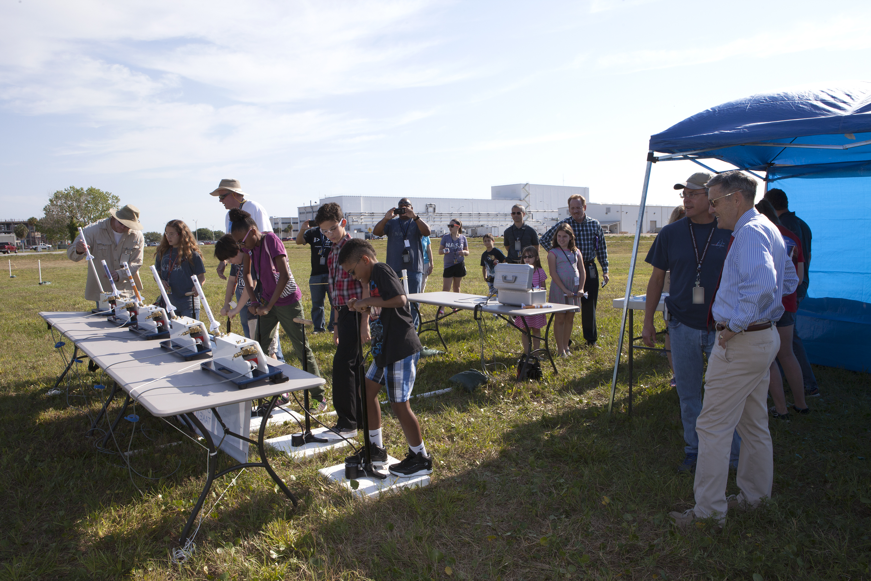 Children launch air rockets during take a child to work day at nasa s kennedy space center