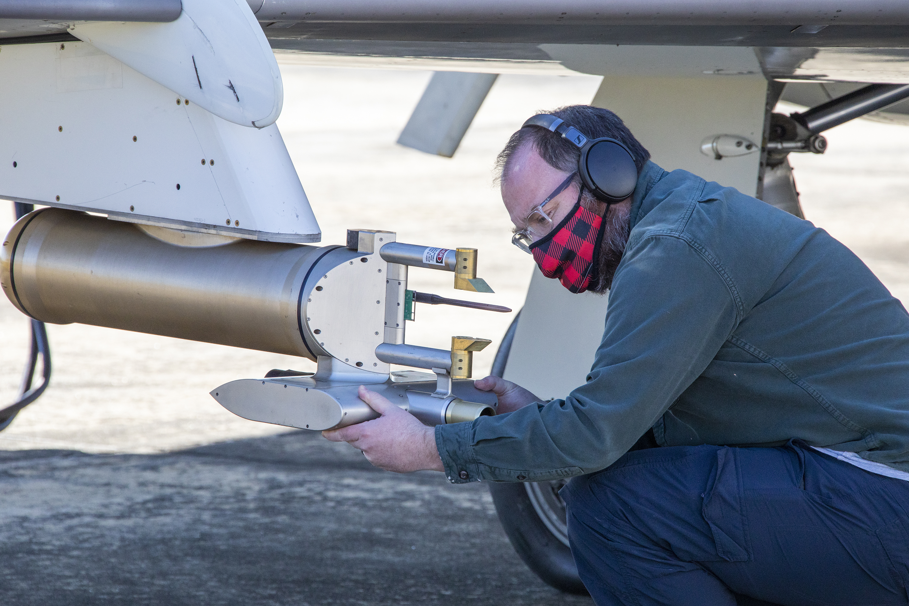 Researcher Luke Ziemba checks an instrument on the Falcon prior to a flight.