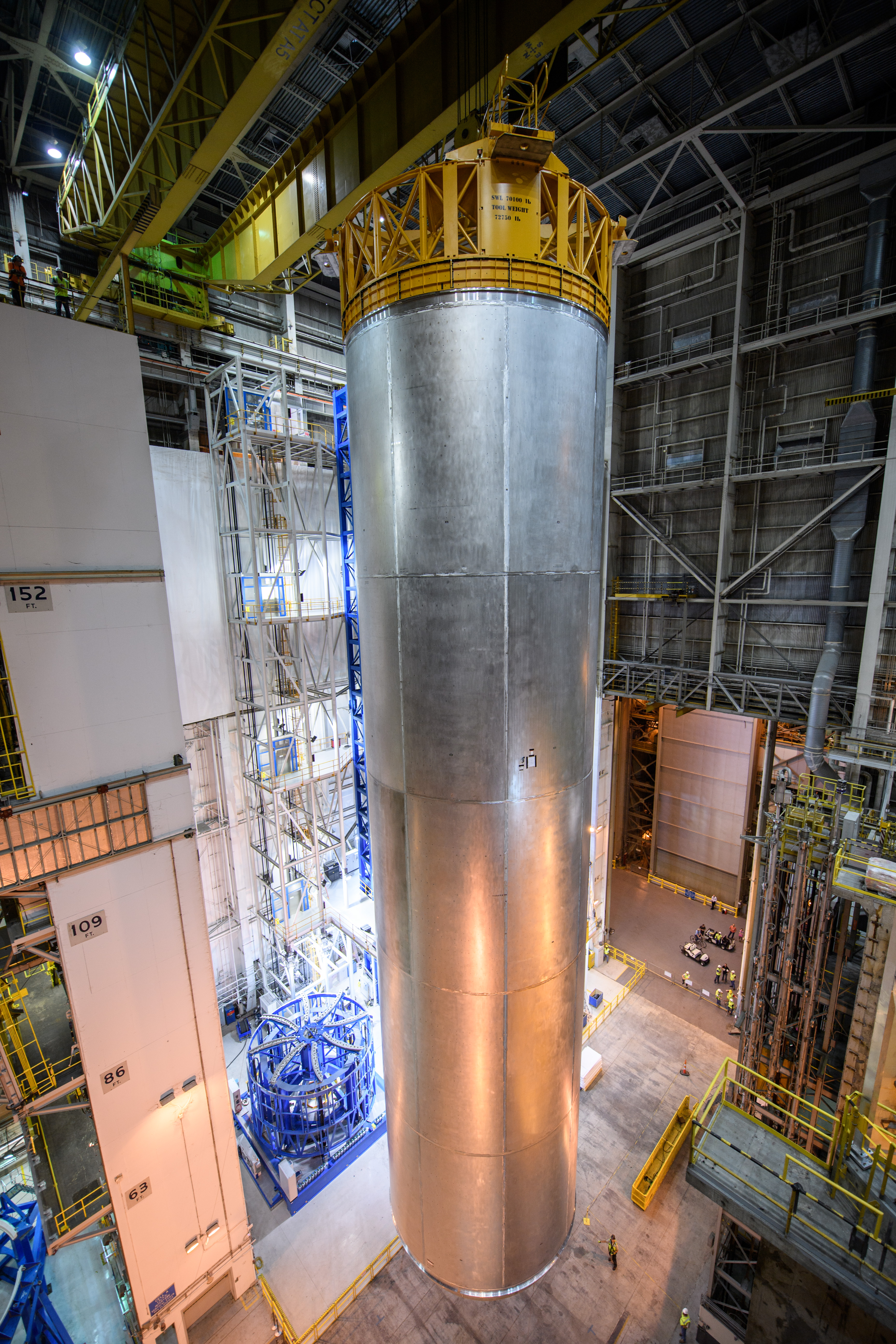 A qualification test article for the tank on the sls is lifted off the vertical assembly