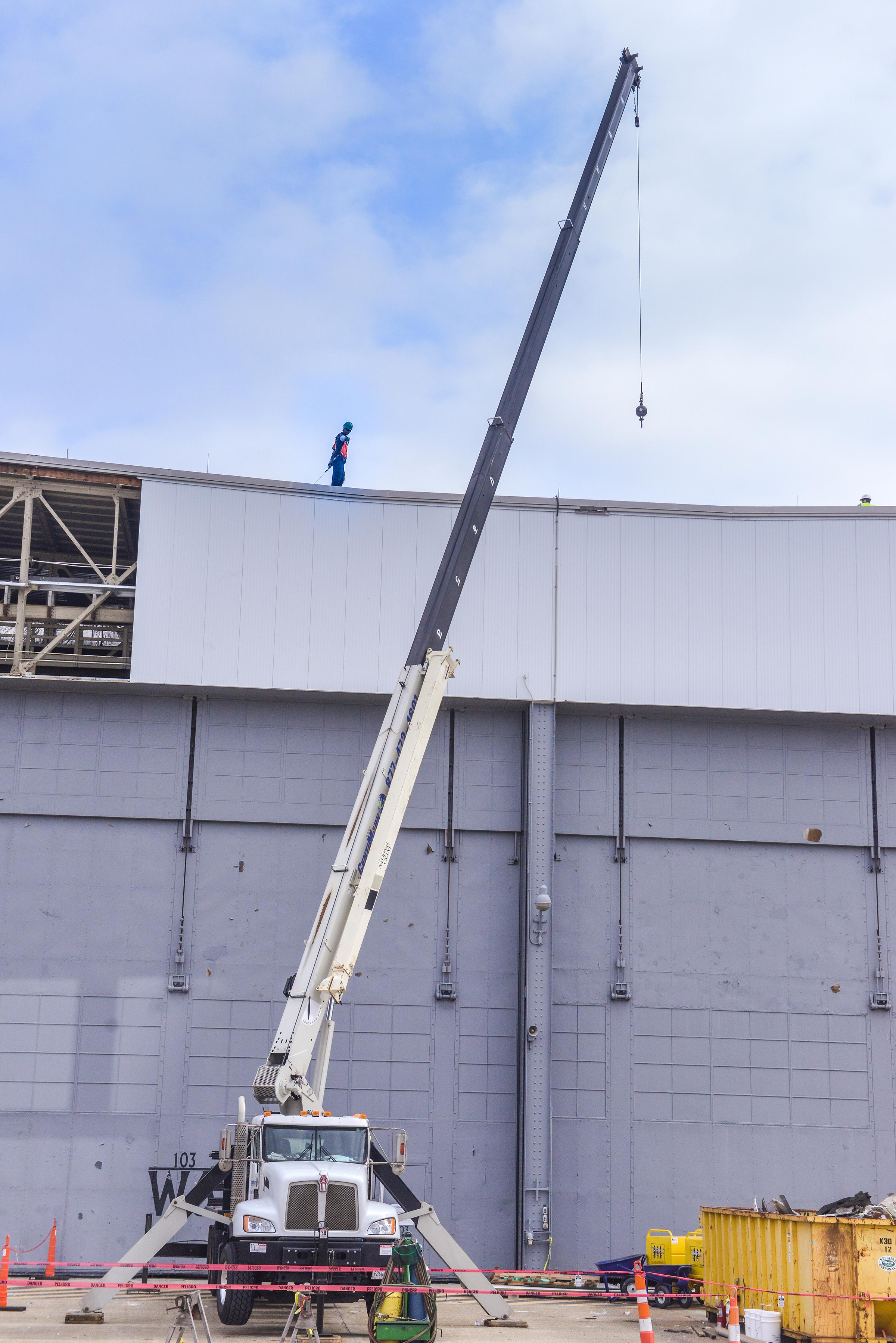 Workers Repair Roof Da...