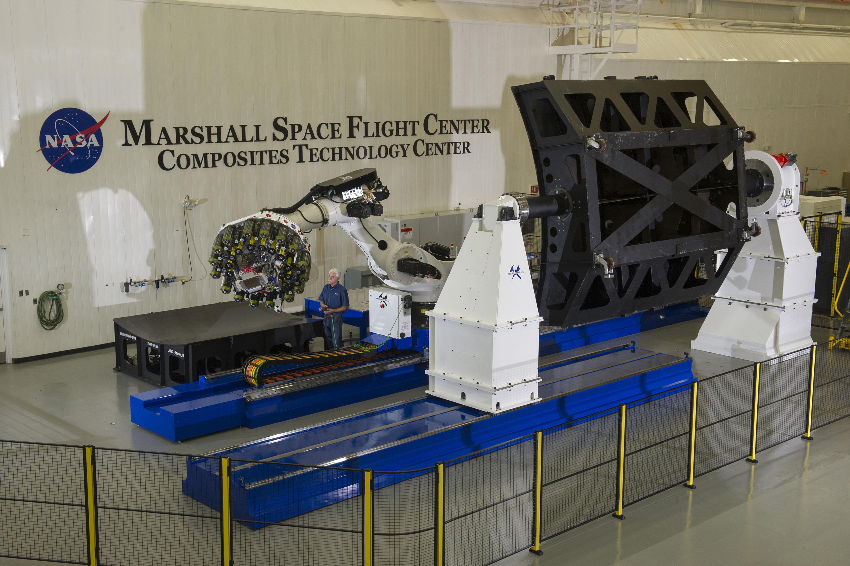 Robot Preparing To Build Large Light Composite Rocket ...