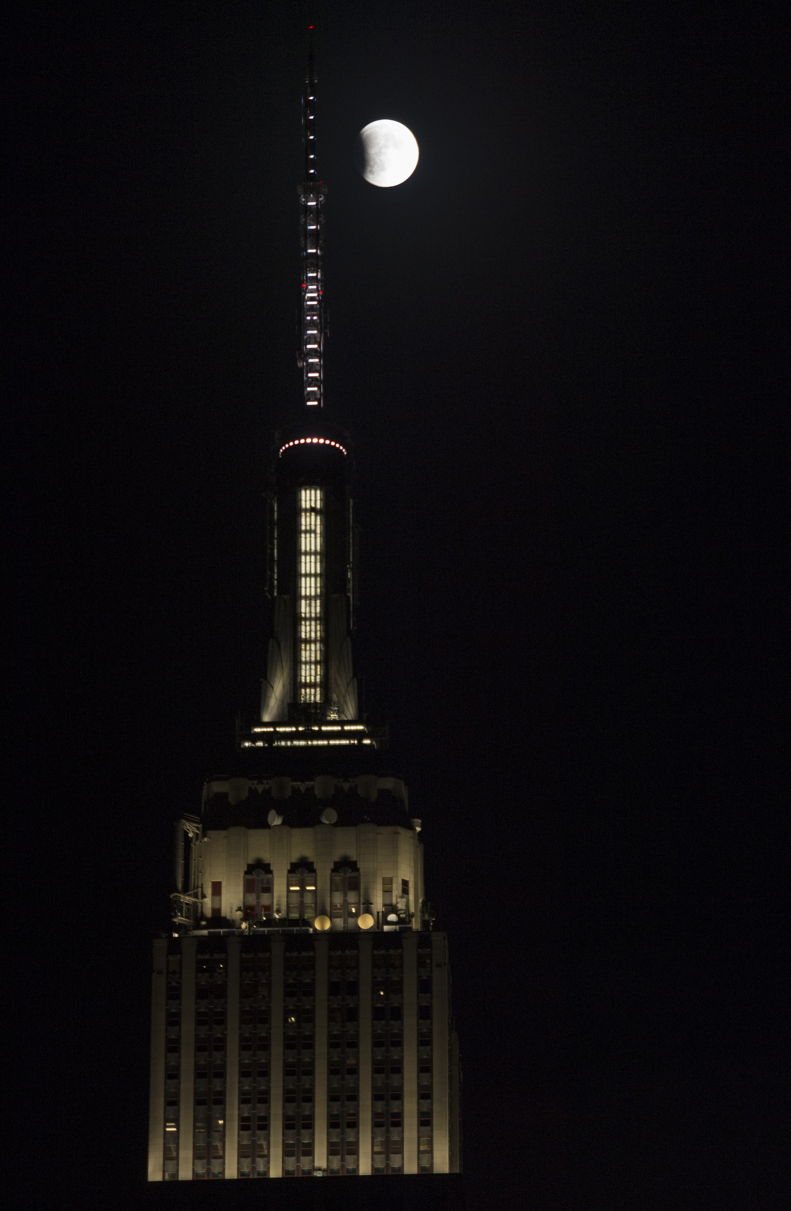 A Perigee Full Moon, Or Supermoon, Is Seen Next To The Empire State Building