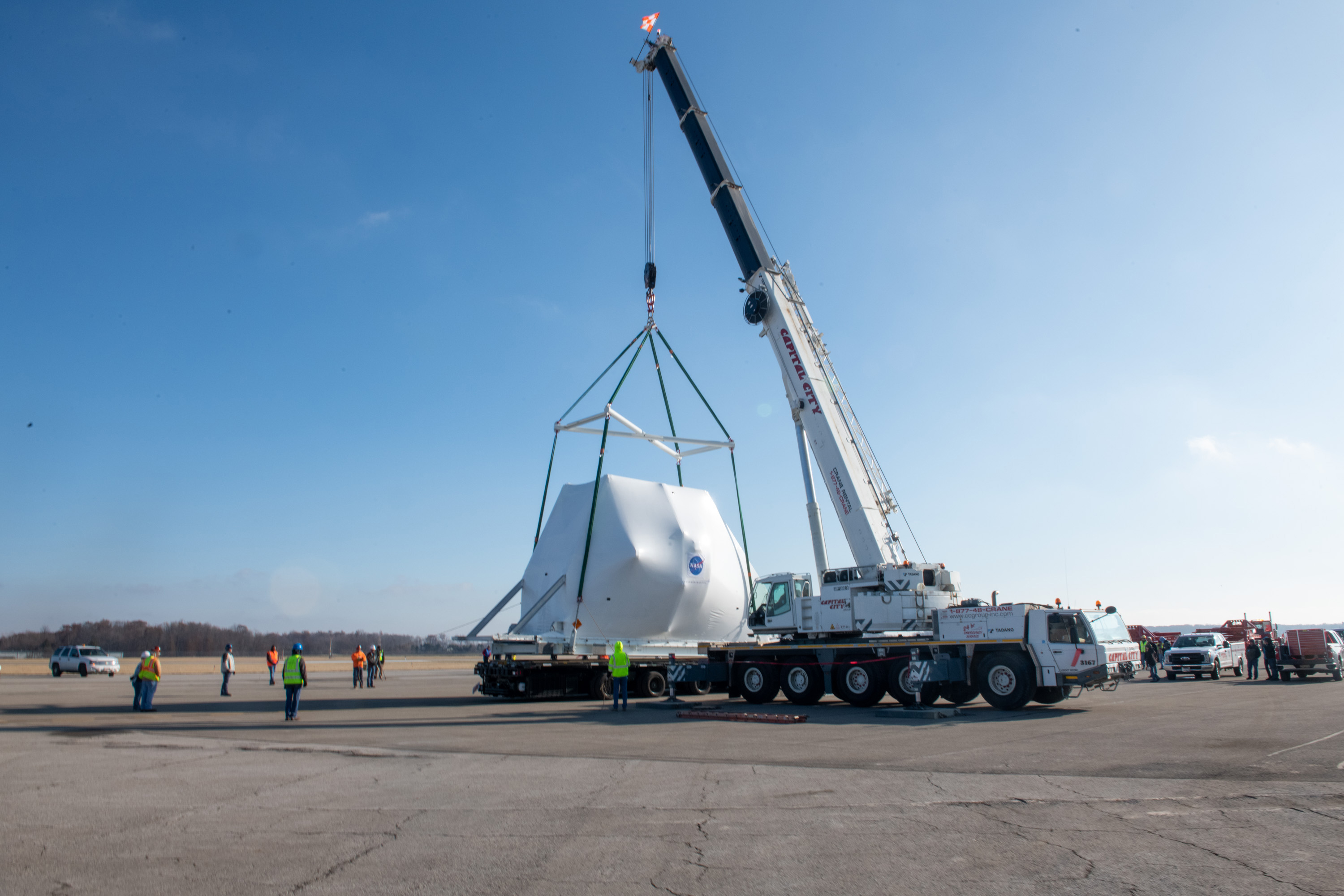 The Orion spacecraft being lifted onto the truck for transport to NASA's Plum Brook Station. Credits: NASA.