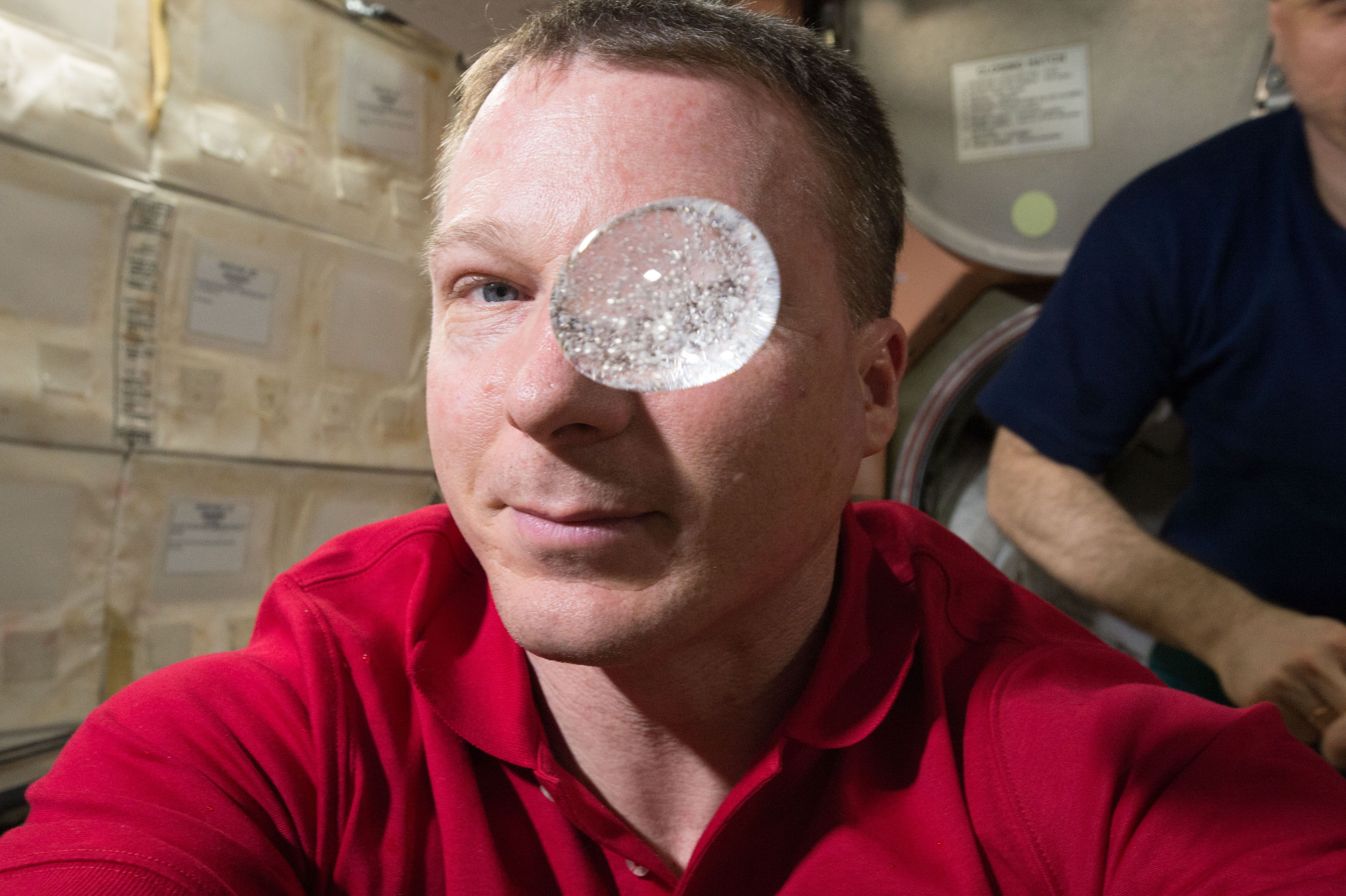 Astronaut Terry Virts inserted an effervescent antacid tablet into a ball of water while crewmates filmed the reaction with the Red Epic Dragon camera. Image courtesy NASA. For a larger version of this image please go here.