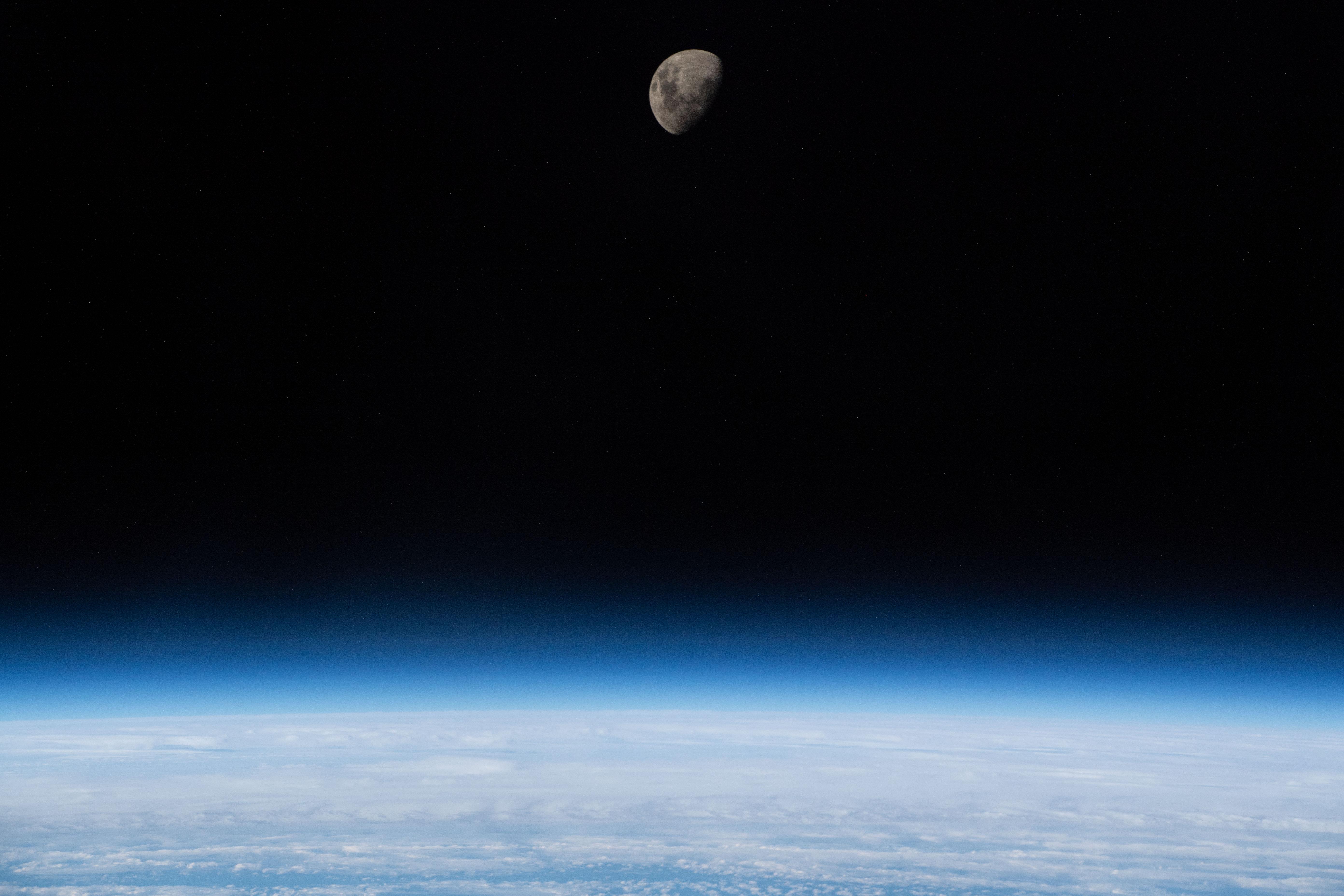 Waxing Gibbous Moon Above Earth's Limb
