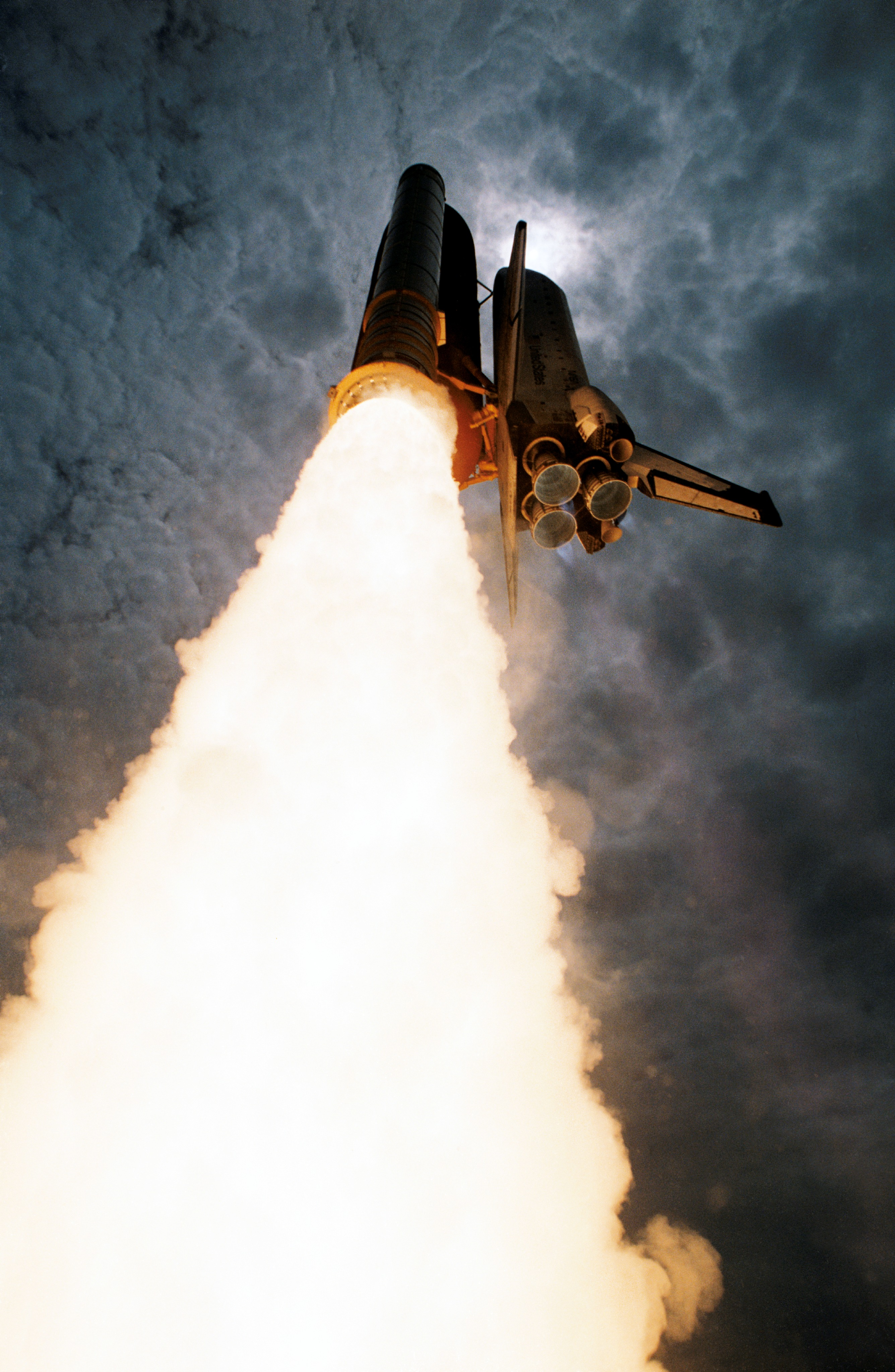 Shuttle Launching Upward To Space Captured From Angle On Ground