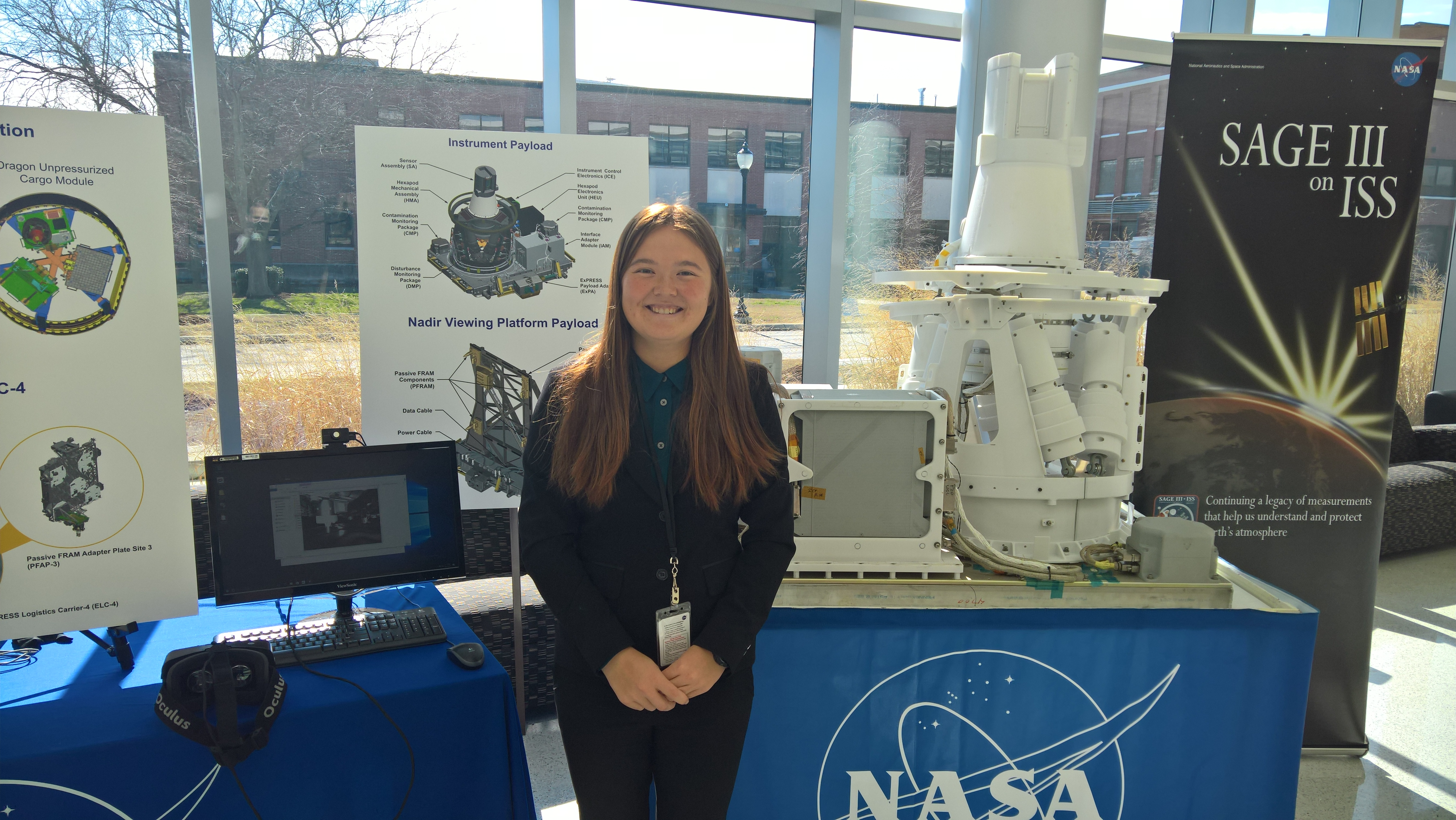 6144f0ebb81 Christine Odenwald poses with a SAGE III on ISS display at NASA Langley.